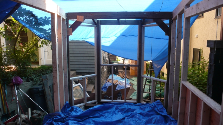 The front framed! the two angled windows are 4 feet tall and will end up dipping behind the kitchen counter, which is going to be a bit of a pain but was worth only spending 40 dollars on two matching windows!